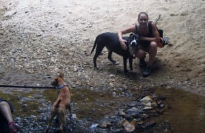 Grace Park technician on a hike at Umstead Park with SPCA dogs as a community service project