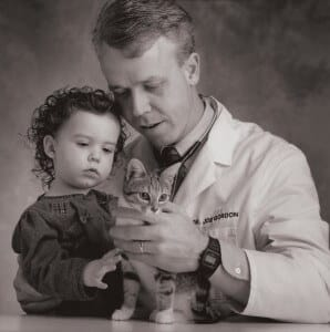 Doctor with child and cat